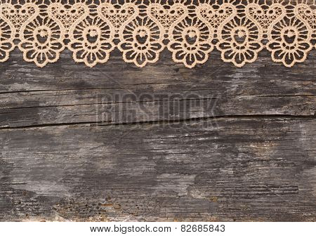 beautiful lace on the wooden background, vintage