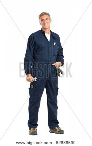 Portrait Of Confident Mature Mechanic With Wrench Looking At Camera Standing Isolated On White Background