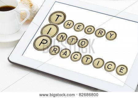 TIP (theory into practice) acronym explained with old typewriter keys on a digital tablet with a cup of coffee