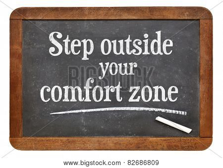 step outside your comfort zone - motivational advice on a vintage slate blackboard