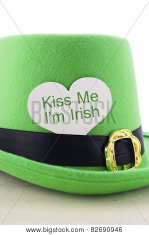 Happy St Patricks Day Green Leprechaun Hat On White Wood Table With Kiss Me I Am Irish Heart Shape G