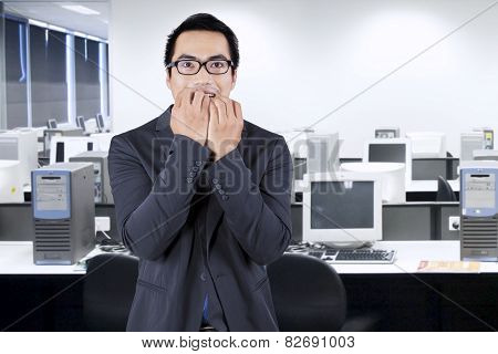 Worried Male Working In Office