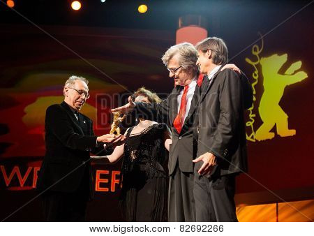 BERLIN, GERMANY - FEBRUARY 12:  D. Kosslick, M. Becker, W. Salles presents the Honorary Golden Bear Wim Wenders. 65th Berlinale at Berlinale Palace on February 12, 2015 in Berlin, Germany.