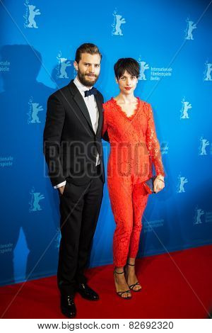 BERLIN, GERMANY - FEBRUARY 11: Actor Jamie Dornan with Amelia Warner, 'Fifty Shades of Grey' premiere. 65th Berlinale International Film Festival at Zoo Palast on February 11, 2015 in Berlin, Germany.