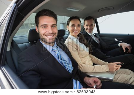 Business team working in the back seat in the car