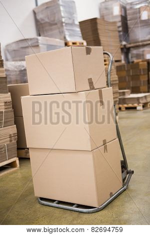 Cardboard boxes on trolley in warehouse