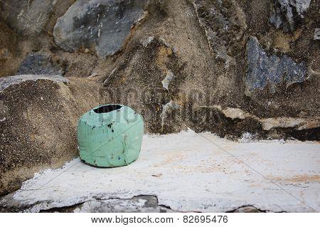 Coconut ashtray left on a stone bench