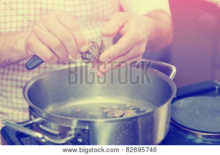 Chef is peeling clams to make seafood broth, toned image