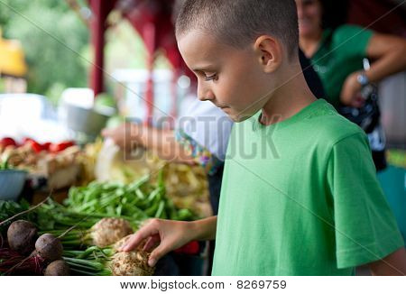 Cute Boy Buying Vegetables
