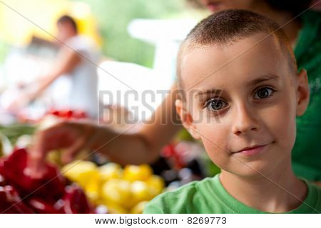 Cute Boy Buying Vegetables