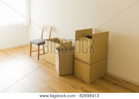 A cardboard box and chair