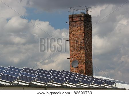 Roof With Solar Panels And Chimney