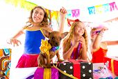 stock photo of dog birthday  - girl friends party dancing with presents and puppy chihuahua dog in birthday - JPG
