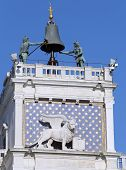 picture of lightning-rod  - venice famous clock tower with blackened statues from the elements called due Mori di Venezia and lion - JPG