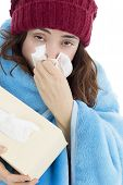 stock photo of sick  - Adult woman sick with a flu sneezing feeling cold and tired - JPG
