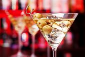 picture of shot glasses  - Several glasses of famous cocktail Martini shot at a bar with shallow depth of field - JPG