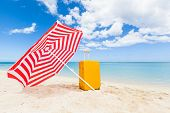 pic of trolley  - red and white sunshade and yellow trolley at the beach Le Morne Mauritius Africa - JPG