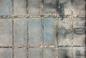 foto of brick block  - Brick work with bricks old white paint marks on the wall - JPG
