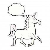 stock photo of unicorn  - cartoon unicorn with thought bubble - JPG