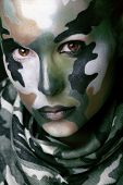 image of khakis  - Beautiful young fashion woman with military style clothing and face paint make - JPG