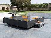 stock photo of gandhi  - Raj Ghat a memorial to Mahatma Gandhi is a simple black marble platform that marks the spot of his cremation.