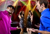 picture of soliciting  - two pickup artists harrassing women at a nightclub - JPG