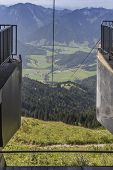 image of bavarian alps  - view into the valley from a cable car summit station in the bavarian alps - JPG