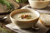 stock photo of leek  - Homemade Creamy Potato and Leek Soup in a Bowl - JPG