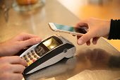 pic of cashiers  - Payment transaction with smartphone  - JPG