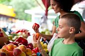 pic of farmers market vegetables  - Cute boy with his mother buying fresh vegetables at the farmer - JPG