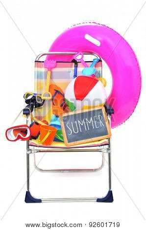 a foldable beach chair full of beach items, such as diving masks, pails and shovels, a beach ball or a swim ring, and a chalkboard with the word summer written in it on a white background