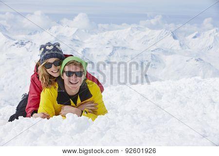 Couple Having Fun On Ski Holiday In Mountains
