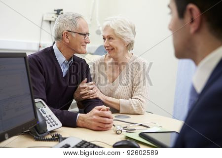 Senior Couple Meeting With Consultant In Hospital