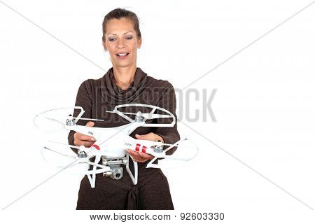 Beautiful young woman with a drone on a white background