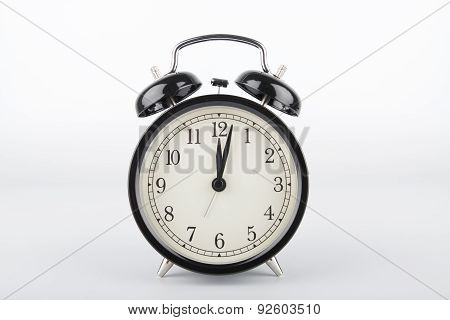 Two Minutes Past Twelve O'clock. Alarm Clock.