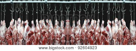Pork Meat Hanged On A Hooks In A Butchery