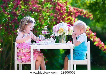 Kids Having Fun At Garden Tea Party