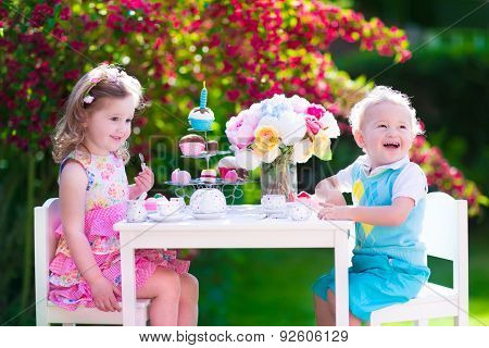 Kids Having Fun At Garden Tea Party