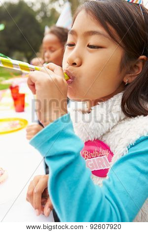 Girl With Blower At Outdoor Birthday Party