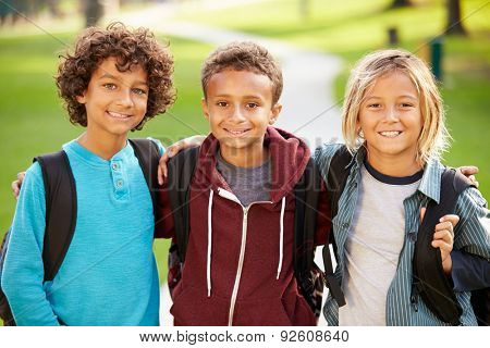 Group Of Young Boys Hanging Out In Park Together