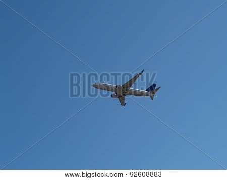 Commercial Jet Liner Climbing Into Blue Sky