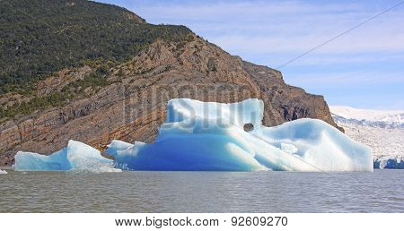 Colorful Iceberg By An Active Glacier