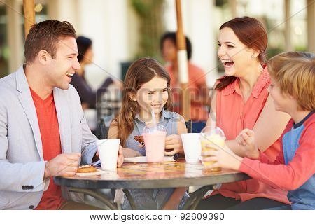 Family Enjoying Snack In Caf\x81_