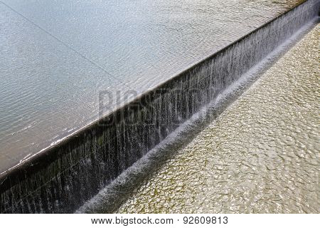 Dam on the river. Industrial background.