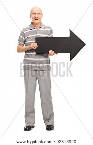 Full length portrait of a cheerful senior gentleman holding an arrow and looking at the camera isolated on white background