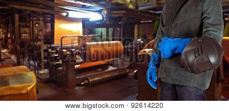 Worker with instruments at industrial factory