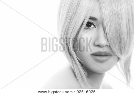 Black and white close-up portrait of young beautiful asian girl with stylish haircut over white background