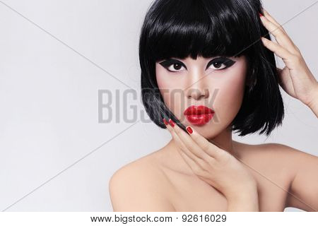 Young beautiful asian girl with stylish bob haircut and red lipstick