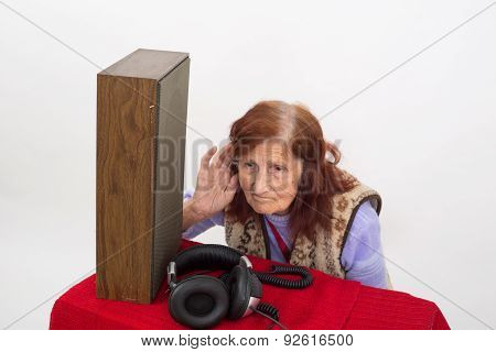Elderly Woman Trying To Hear Radio.
