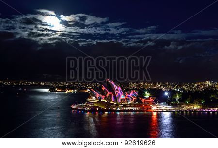 SYDNEY AUSTRALIA - JUNE 5 2015; Top view of The Sydney Opera House illuminated with colourful light
